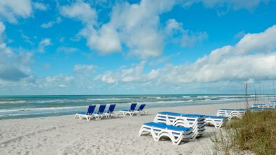 We have new comfortable beach chairs on our beach, umbrella is in the unit