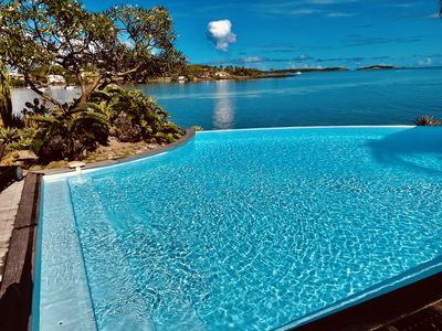 Photo for Luxury villa, feet in water, panoramic sea view, pool