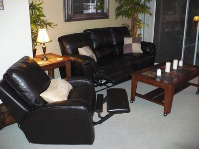 Relax in leather reclining sofa and chairs.