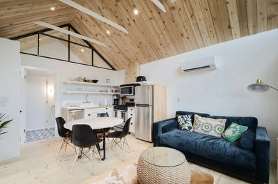 Living Area - Our open studio has high vaulted ceilings and nice modern decor