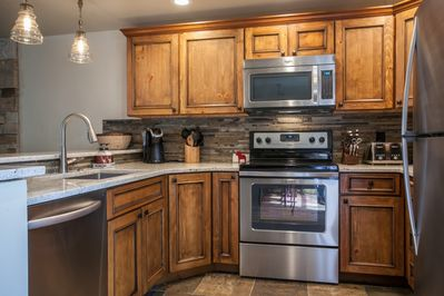 Remodeled kitchen with granite counter tops, stainless steel appliances and all the amenities needed to cook a great meal.