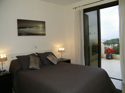 Ground floor bedroom king size with patio and views of sea and mountains