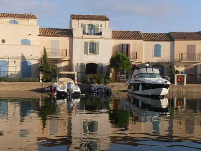 Photo for Provençal style waterfront villa on private marina with shared pool