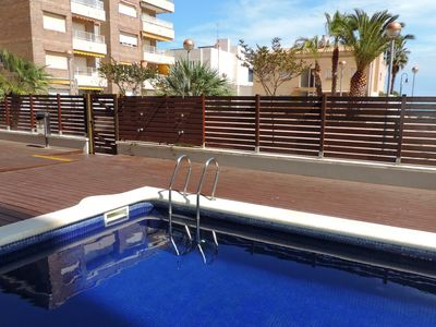 Photo for AT030 FRANCESC MACIÀ: Apartment with pool and parking a few steps from the beach