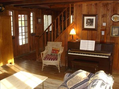 Craftsman wide board oak floors and pine walls hewn from nearby trees