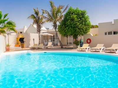 Photo for Villa Sol: Heated Private Pool, Walk to Beach, WiFi, Car Not Required