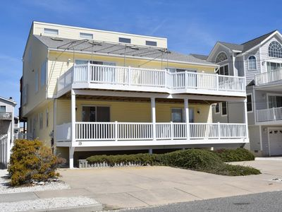 Photo for In a word, wow.  BEACHBLOCK property is just steps away from the beach. Skylights brighten the large living room area Four decks!!