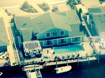 Photo for Paradise - Heated Pool, Kayaks, Bikes, Paddle Boards.  Steps away from the beach