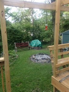 The rustic fire pit from the back deck.