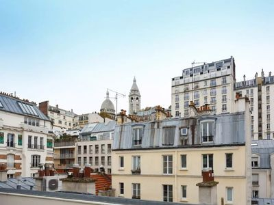 Photo for Charm of a typical Parisian flat with a beautiful view on the Sacred Heart