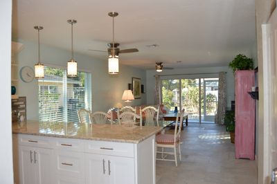 Beautiful open layout kitchen with countertop barstool seating.