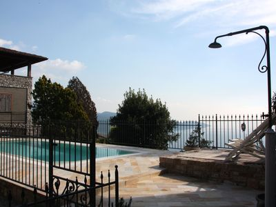 Photo for Romantic apartment in Rustico with pool and panoramic views of Lake Garda