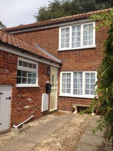 Photo for Riverside village cottage in the heart of the Norfolk Broads