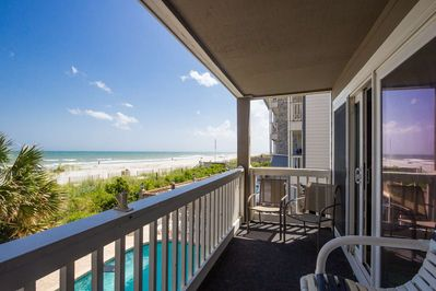 Feel the ocean breeze as you watch dolphins and miles of Surfside Beach