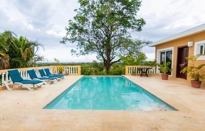 Photo for Capture sea breezes from the pool deck of this private vacation villa.