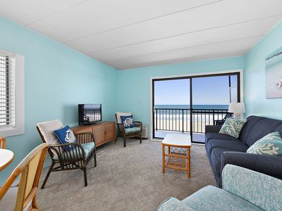 Beautiful 1 bedroom oceanfront condo with fabulous blue color palette, free WiFi, and an indoor pool located right on the boardwalk!