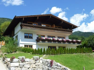 Photo for Spacious apartment with private garden & mountain views - sleeps up to 8 people!