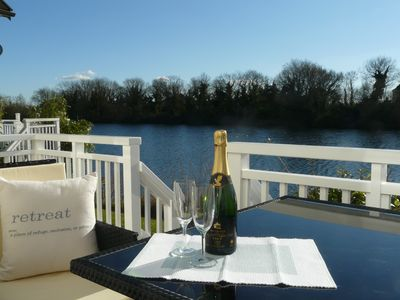 Photo for Stunning pet friendly lakeside vacation lodge and the perfect Cotswold retreat