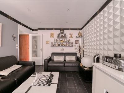 Photo for Atypical apartment with sunny terrace