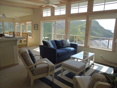 Living room overlooking the beach, ocean and mountain range