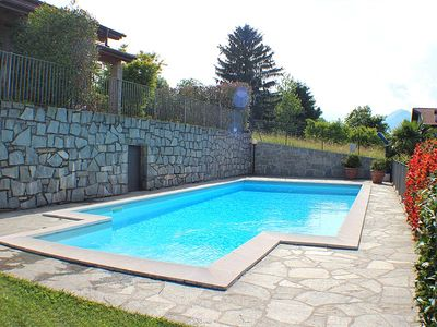 Photo for » Equiped with all modern conveniences and pool  » stunning mountain views » modern Italian design  » with spa area