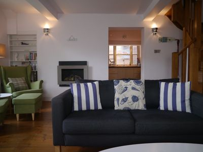 Photo for Oar House - overlooking the village green, 5 mins from the quayside and beach