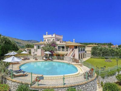 Photo for 6 bedroom Villa, sleeps 14 with Air Con, FREE WiFi and Walk to Beach & Shops