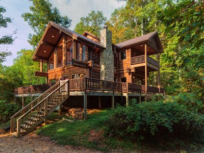 Photo for Secluded log cabin with fireplace and hot tub on deck.