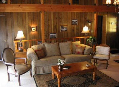 The great room also features giant beams and rustic but refined mountain decor.