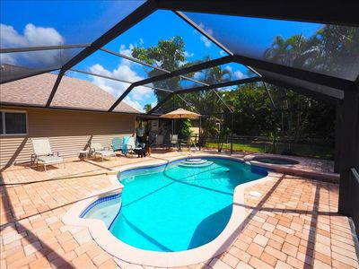 Photo for Vanderbilt Beach House - 4 bedrooms - Heated pool and Hot Tub - Walk to the Beach