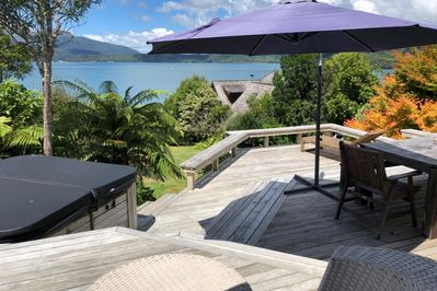 View of the deck. Gorgeous spaces to relax and soak in the view or have a spa