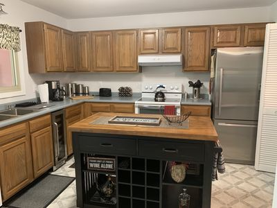 Full-sized/fully equipped kitchen, featuring island and built-in wine cooler