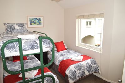 Bedroom with single and bunks - ideal for 2 adults or three kids