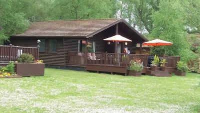 Photo for Lodge with hot tub overlooking fishing lake with private fishing peg