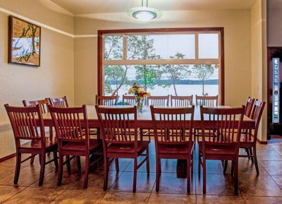 Custom made dining room table seats 14 with a view of Hood Canal and Dabob Bay