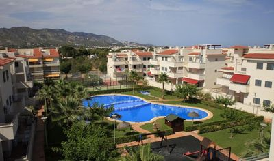 Photo for 2 bedroom apartment with terrace, pool and paddle