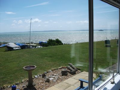 panoramic sea views across The Solent to the Isle of Wight from lounge & gardens