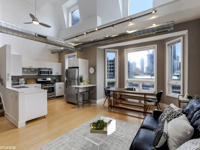 Photo for DOWNTOWN! 7BED/2BATH! PRIVATE ROOFTOP! Sleeps 14!!