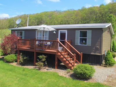 Photo for Paddlington Bear Cottage---Quick Access to Water, Sunsets and Ski Resorts Await