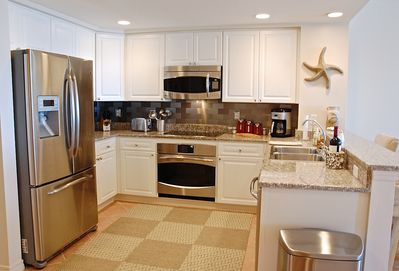 Kitchen with entirely new appliances, cookware, and serveware.