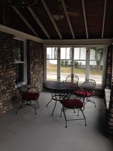 Eating area in sunroom.  The windows open like french doors.  2 ceiling fans.
