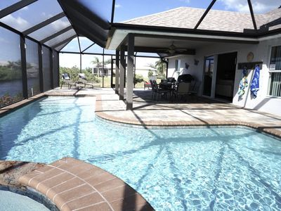 Photo for Marianne - Cape Coral 4br/2ba home w/electric and solar heated pool/spa, gulf access canal, HSW Inte
