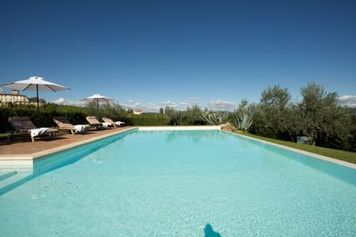Pool's white lining reflects Tuscan blue skies