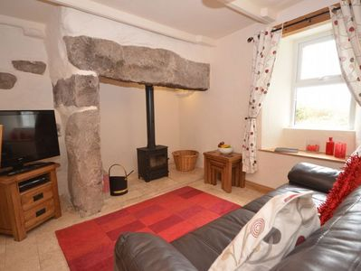 Cosy lounge area with feature fireplace and woodburner