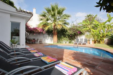 Spacious, well planted garden with pool, terrace and breakfast area near kitche