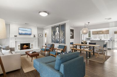 Open floor plan is great for entertaining. Mid century style and fun art.