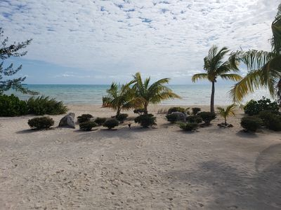 Photo for *NEW LISTING*PROMOTIONAL RATES*Spectacular beachfront calm water sunset property