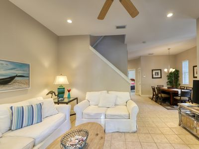 Photo for Serene home w/ screened porch, balcony & 2 shared pools - steps to beach!