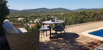 Stunning and relaxing panoramic views from the pool terrace overlooking gardens