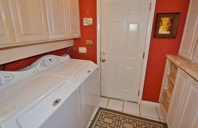 Laundry Room downstairs, leading into garage